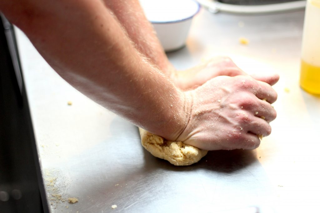 Luke Robinson kneading dough