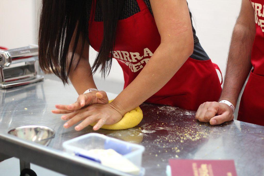 Student kneading dough