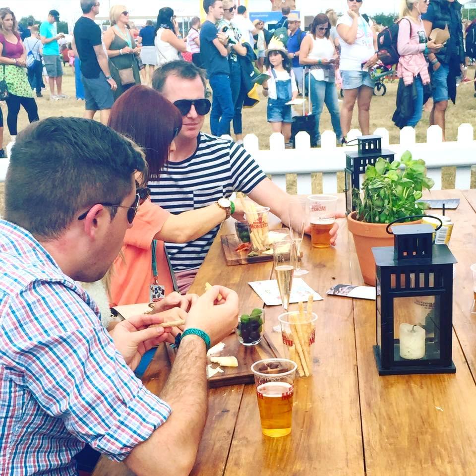 Guests enjoying antipasti at table