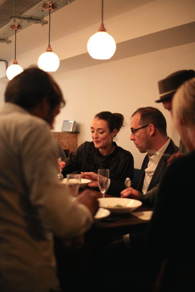 Customers sharing a bowl of pasta