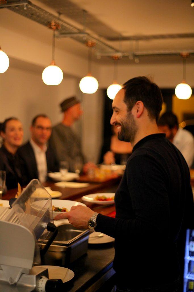 David Toscano, owner of Cin Cin, serving bowls of food