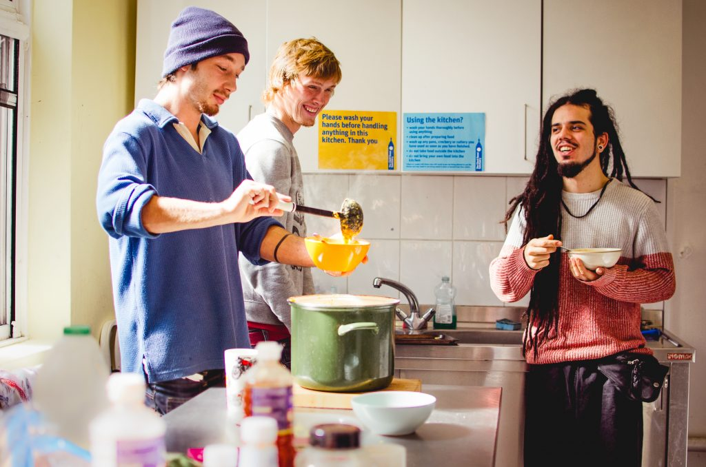 Young people making soup together