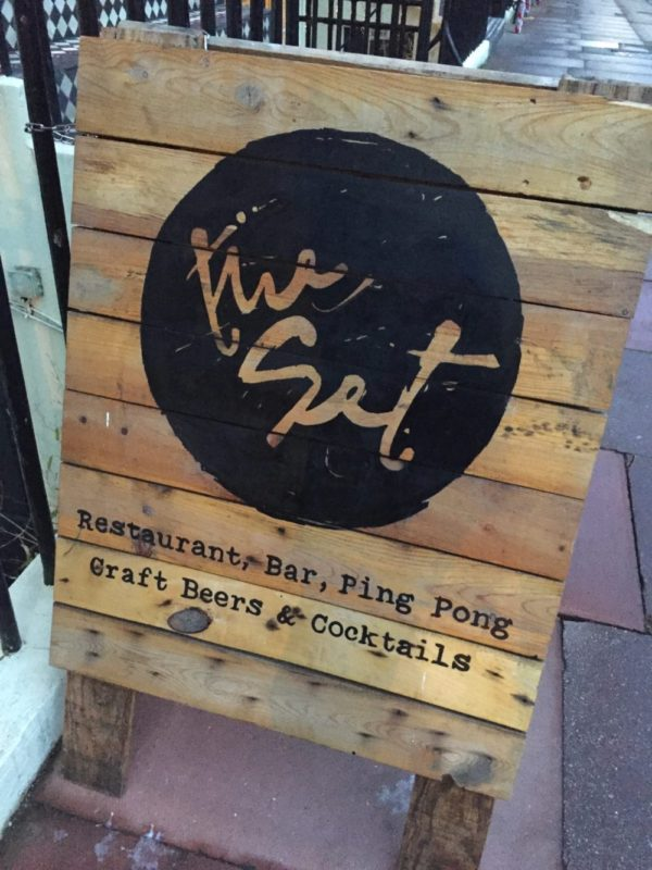 A sign promoting the Set restaurant