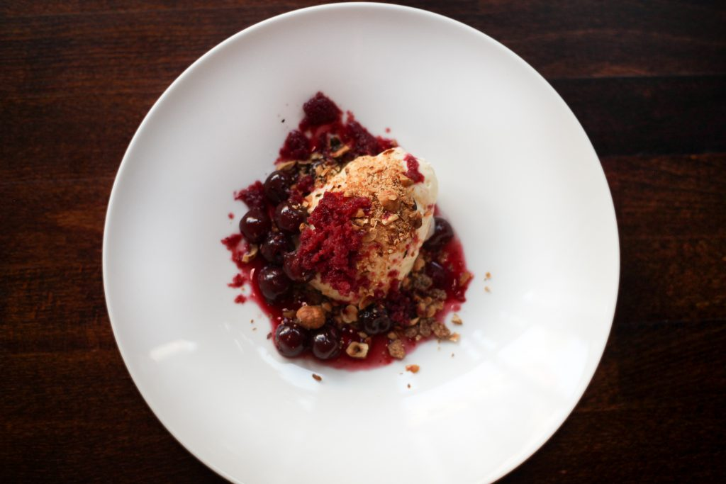 White chocolate mousse with cherry granita and hazelnuts
